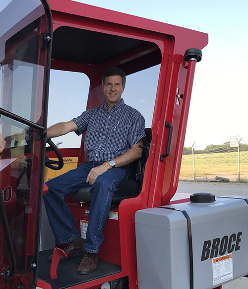 CEO Alan Vance sits in the new cabbed BW-260 sweeper