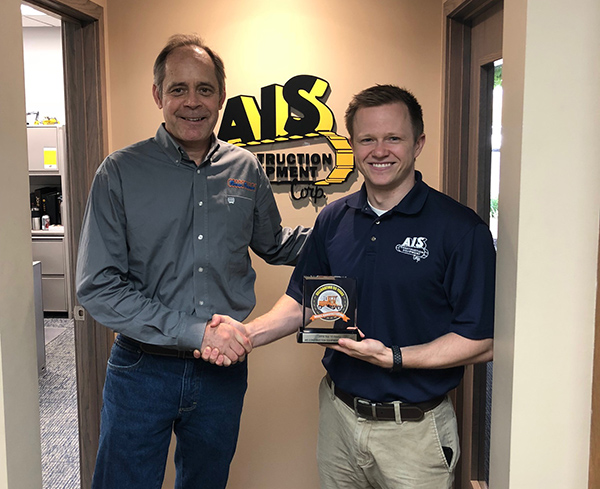 Evan Lowery, Inventory Manager of AIS Equipment pictured with Broce Sales Rep Dave Krason, accepting their top 10 dealer award.