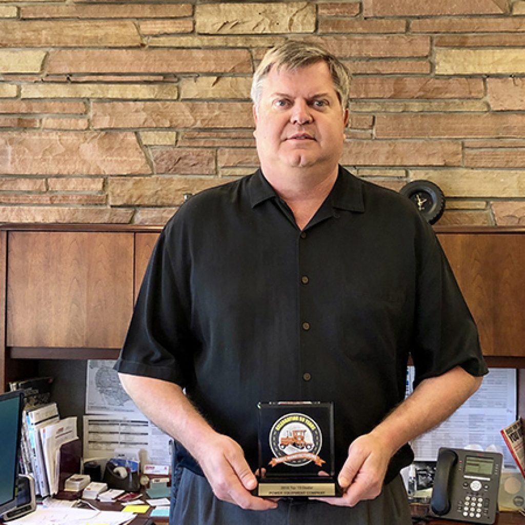 Matt Mergens VP of Sales accepts the Broce top 10 dealer award for Power Equipment Company