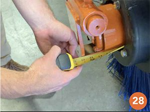 "Photo shows tape measure being used to verify that the brush is 13"" on and makes a good fit."