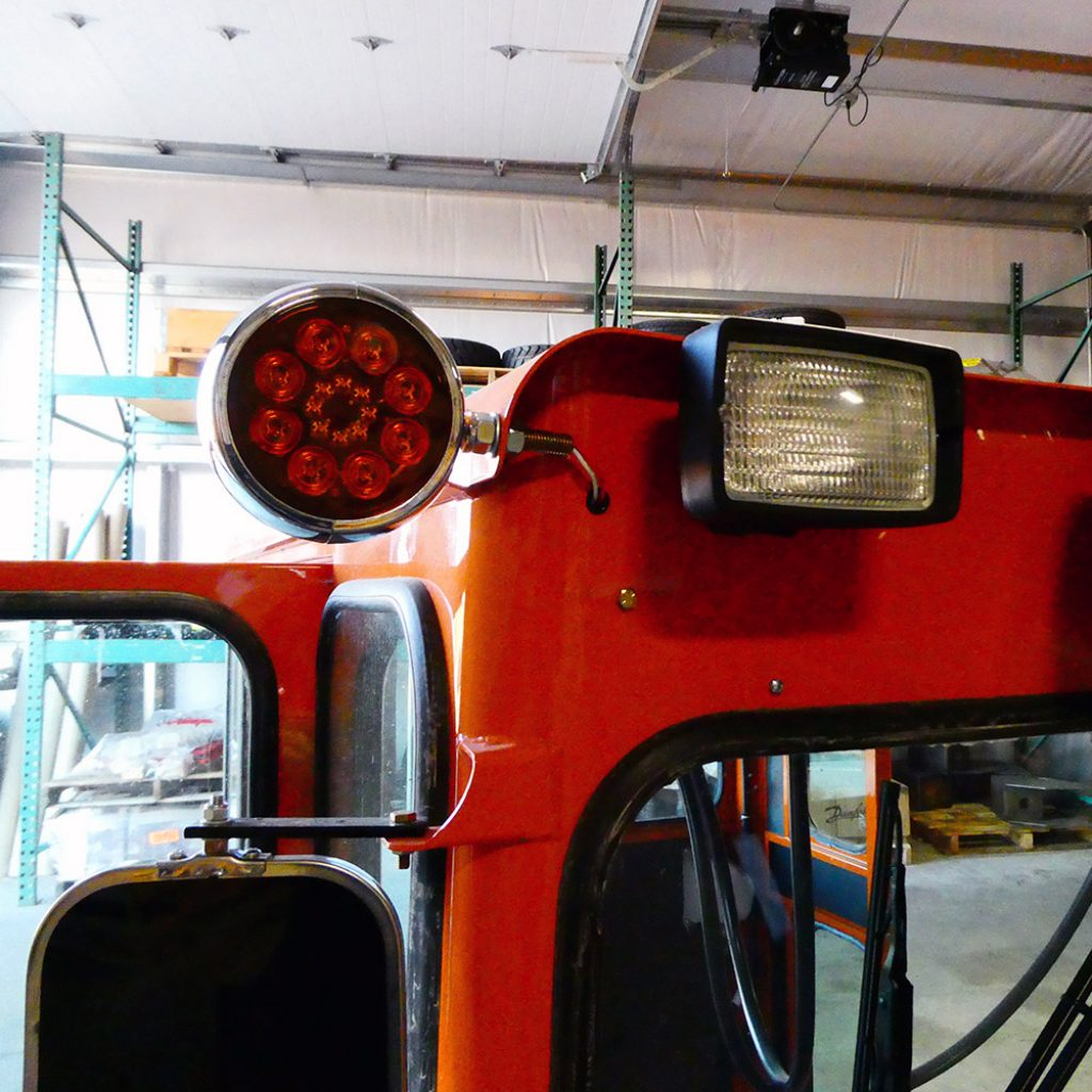 Final view of the work lights after they were installed on a Broce broom